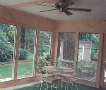 interior of sunroom with ceiling fan